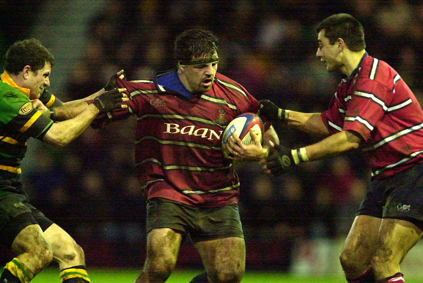 Photo - Peter Spurrier.28/12/2002.Sport - Rugby - Zurich Premiership .Northampton Saints v Gloucester RFC.Gloucester's hooker Olivier Azam breaking from the ruck