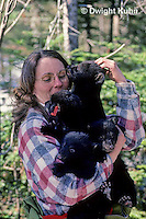 MA01-061z  Black Bear - wildlife biologist holding tagged cubs removed by biologists from winter den - Ursus americanus