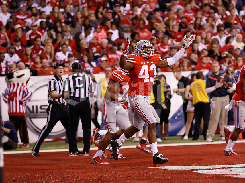 Ohio State Buckeyes linebacker Darron Lee (43) celebrates a touchdown by defensive lineman Joey Bosa (97) on a fumble recovery during the second quarter of the Big Ten Championship game against the Wisconsin Badgers at Lucas Oil Stadium in Indianapolis on Dec. 6, 2014. (Adam Cairns / The Columbus Dispatch)