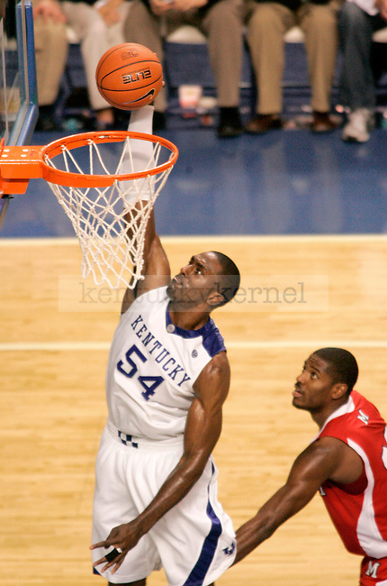 Junior forward Patrick Patterson dunks the ball during the second half of the game at Rupp Arena Monday night. Patterson finished with 17 points after the Cats' 72-70 victory over the Redhawks..Photo by Zach Brake | Staff