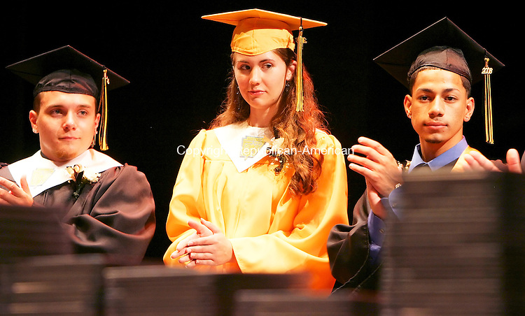WATERBURY CT. 18  June 2008-061808SV11--From left, Valedictorian Shawn Smith, Salutatorian Krista Ann Wolffer, and Class President Ivan Roman on stage at the Kaynor Tech. graduation ceremony at the Palace Theater in Waterbury Wednesday.<br /> Steven Valenti Republican-American