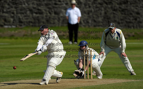 Aberdeenshire CC V Grange CC, Lloyds TSB Scottish Cup, played at Mannofield, Aberdeen - Grange batsman Cameron Coles (who went on to top-score for the Edinburgh side, on 95) hits out as 'Shire keeper Matthew Cross and fielder Neil MacRae looking for a slip - Picture by Donald MacLeod 21.06.09