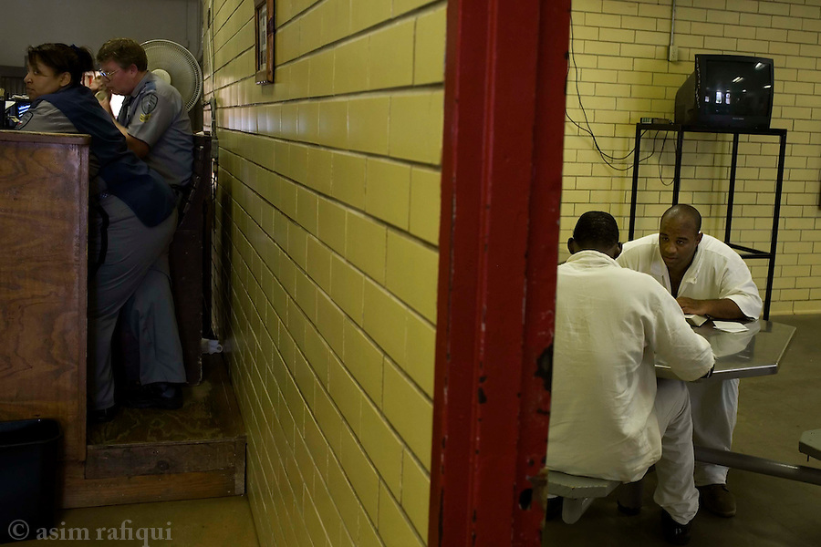 Inmates at a bible study session in the common room<br />