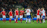 Tempers flare after Vladimir Stojkovic of Serbia races from his goal to argue a decision during the FIFA World Cup Qualifying match between Wales and Serbia at the Cardiff City Stadium, Cardiff, Wales on 12 November 2016. Photo by Mark  Hawkins.