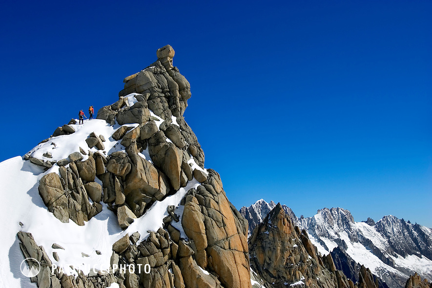 Climbers on the Midi Plan Traverse high above Chamonix Valley in the French Alps