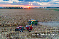 63801-12507 Harvesting corn and unloading into grain cart in fall at sunset-aerial  Marion Co. IL