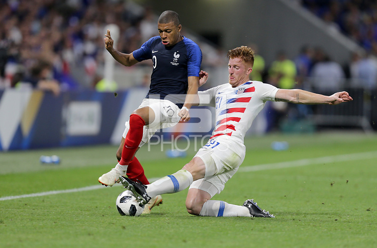 Lyon, France - Saturday June 09, 2018: Kylian Mbappé, Tim Parker during an international friendly match between the men's national teams of the United States (USA) and France (FRA) at Groupama Stadium.