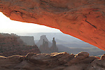 Sunrise at Mesa Arch, Island in the Sky area, Canyonlands National Park, Utah, USA. .  John offers private photo tours in  Canyonlands National Park and throughout Utah and Colorado. Year-round.