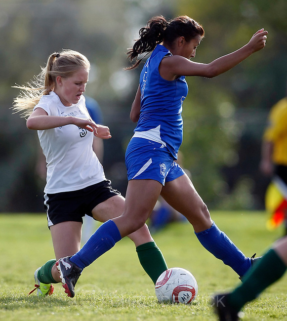 Chris Detrick  |  The Salt Lake Tribune.Rowland Hall's Katie White (3) kicks around Gunnison's Yisel Perez (7) during the 2A playoff game  Wednesday October 12, 2011.