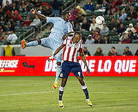 CARSON, CA - April 1, 2012: CJ Sapong (17) of KC and Oswaldo Minda (8) of Chivas during the Chivas USA vs Sporting KC match at the Home Depot Center in Carson, California. Final score Sporting KC 1, Chivas USA 0.