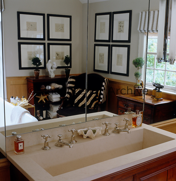 The sink in the master bathroom is an antique commode refitted with a limestone double basin