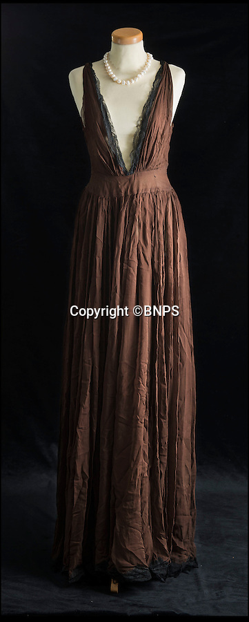 BNPS.co.uk (01202 558833)<br /> Pic: PhilYeomans/BNPS<br /> <br /> The silk Balmain negligee worn by Loren when attempting to seduce Sellers in the movie is also in the sale.<br /> <br /> Dressed to thrill - the stunning dress that led to Peter Sellers infatuation with screen goddess Sophia Loren is coming up for auction - but you may have to actually be a Miliionairess to afford it.<br /> <br /> Sophia Loren stripped off the salmon pink Balmain gown in a racy scene from the 1960 blockbuster 'The Millionairess' and unlikely leading man Peter Sellers was so entranced by the beautiful young italian star that he offered to leave his new wife for her.<br /> <br /> Dukes auctioneers in Dorchester are now selling the dress along with two others from the film and haute couture expert Antoinette Rogers says it could go for up to £10,000 thanks to its unique and glamorous provenance.
