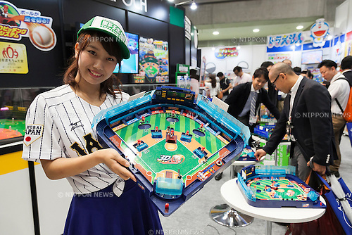 An exhibitor shows a ''3D Yakyuban'' baseball table game at the International Tokyo Toy Show 2015 in Tokyo Big Sight on June 18, 2015, Tokyo, Japan. Japan's largest trade show for toy makers attracts buyers and collectors by introducing the latest products from different toymakers from Japan and overseas. The toy fair showcases about 35,000 toys from 149 domestic and foreign companies and is held over four days. (Photo by Rodrigo Reyes Marin/AFLO)