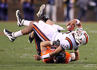 CHARLOTTESVILLE, VA- NOVEMBER 12: Quarterback Logan Thomas #3 of the Virginia Tech Hokies is sacked by defensive tackle Nick Jenkins #96 of the Virginia Cavaliers during the game on November 28, 2011 at Scott Stadium in Charlottesville, Virginia. Virginia Tech defeated Virginia 38-0. (Photo by Andrew Shurtleff/Getty Images) *** Local Caption *** Nick Jenkins;Logan Thomas