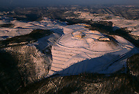 Fresh snow on what was a mountain reveals contours of a valley fill on a mountaintop removal mine.
