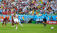 Thomas Muller of Germany scores a goal to make the score 1-0 from a penalty