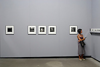 Woman watching photos at exhibition