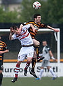 Stirling's Darren Lee Smith gets a slap from Alloa's Iain Flannigan.