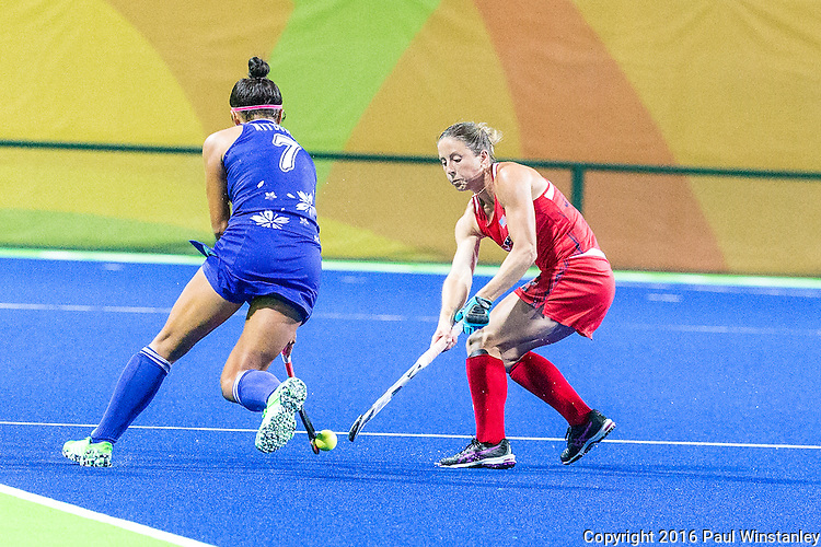 Julia Reinprecht #12 of United States tackles Aki Mitsuhashi #7 of Japan during USA vs Japan in a Pool B game at the Rio 2016 Olympics at the Olympic Hockey Centre in Rio de Janeiro, Brazil.