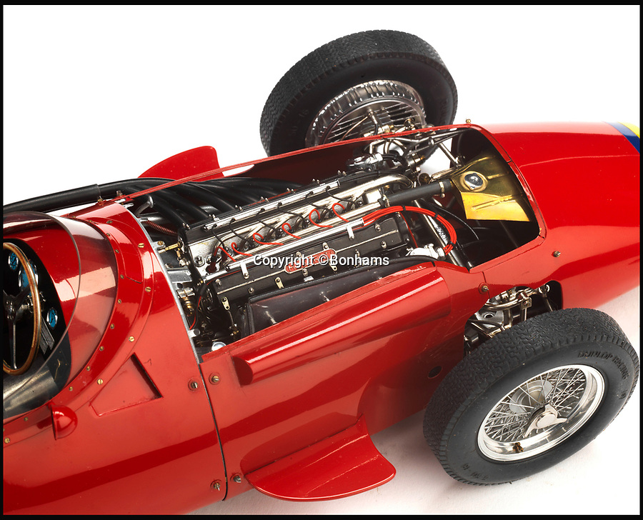 BNPS.co.uk (01202 558833)<br /> Pic: Bonhams/BNPS<br /> <br /> Bidding frenzy for a foot long Maserati...<br /> <br /> An exceptionally precise scale model car comprising 4,000 individual parts that took an engineer nearly 200 full days to build has sold for £21,000. <br /> <br /> The sophisticated 1:13 scale model is an exact reproduction of Maserati's 250F 1960s Formula One racing car that includes an exhaust system, tyre tread detailing and  functioning suspension. <br /> <br /> Each component was based on carefully taken measurements and drawings of a full size 250F then constructed from scratch. <br /> <br /> The model was sold, along with an engraved brass plaque by the modelmaker, at the Goodwood Festival of Speed in West Sussex at the weekend.