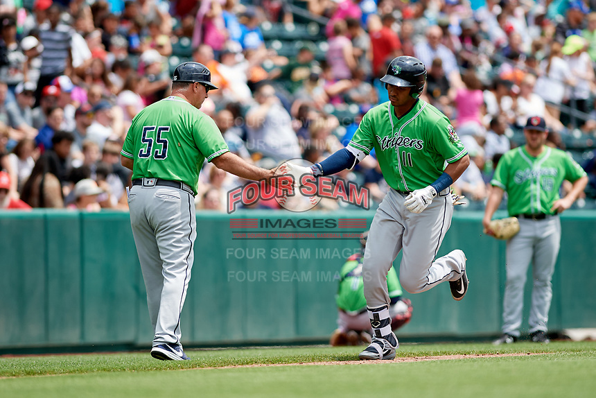 Gwinnett Stripers first baseman Carlos Franco (11) is congratulated by manager Damon Berryhill (55) as he rounds third base after hitting a home run in the top of the seventh inning during a game against the Columbus Clippers on May 17, 2018 at Huntington Park in Columbus, Ohio.  Gwinnett defeated Columbus 6-0.  (Mike Janes/Four Seam Images)