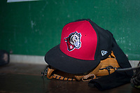 A Billings Mustangs hat rests in the dugout before a Pioneer League game against the Ogden Raptors at Lindquist Field on August 17, 2018 in Ogden, Utah. The Billings Mustangs defeated the Ogden Raptors by a score of 6-3. (Zachary Lucy/Four Seam Images)