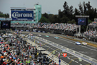 04/20/08 Mexico City .Colin Braun (16,R) duels with Scott Pruett for the lead on the opening lap.