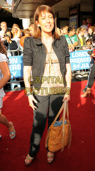 "FAYE RIPLEY .Attending the ""High School Musical"" stage show Press Night at the Hammersmith Apollo Theatre, London, England, UK, July 5th 2008..outside arrivals full length black jacket trousers brown bag .CAP/CAN.©Can Nguyen/Capital Pictures"