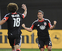 D.C. United midfielder Danny Cruz (2) celebrates with teammates Nick DeLeon (18) his score of the game in the 66h minute of the game. D.C. United defeated FC Dallas 4-1 at RFK Stadium, Friday March 30, 2012.