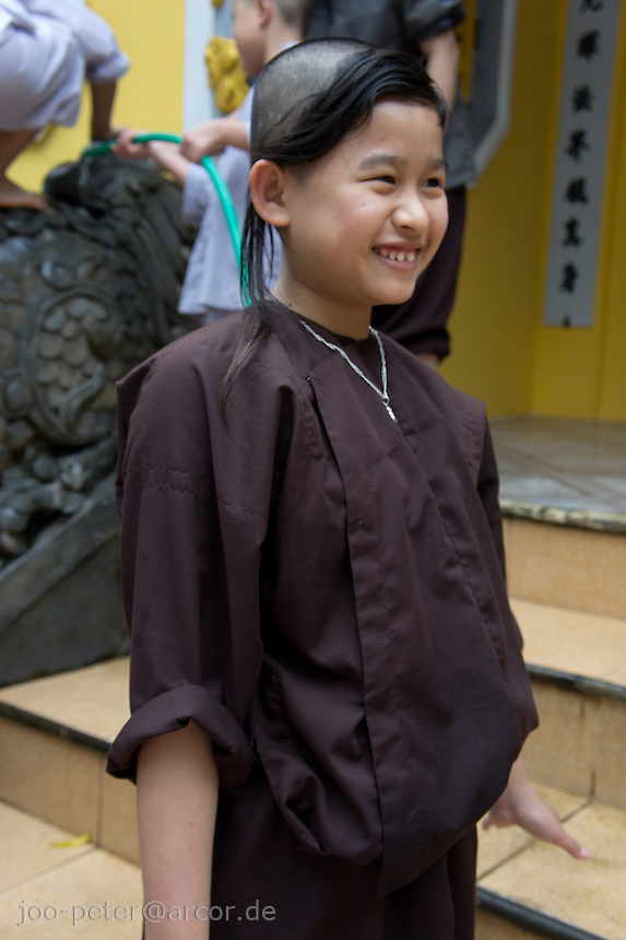 young monk in monastry outside city Hue, Vietnam