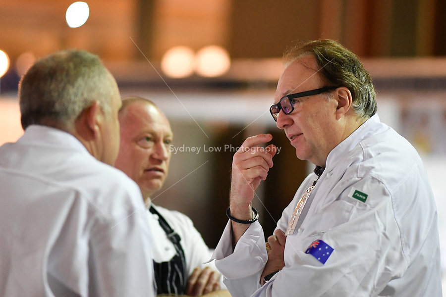 Melbourne, 30 May 2017 - Head judge Philippe Mouchel from the Philippe Restaurant kitchen invigilator judge talks to Tom Milligan of the Bocuse d'Or Academy Australia at the Australian selection trials of the Bocuse d'Or culinary competition held during the Food Service Australia show at the Royal Exhibition Building in Melbourne, Australia. Photo Sydney Low