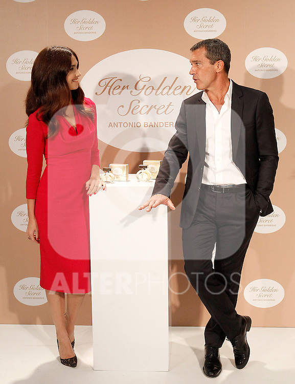 Spanish actors Paz Vega (l) and Antonio Banderas attend the presentation of the perfume 'Her Golden Secret'. September 10, 2013. (ALTERPHOTOS/Acero)