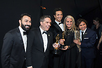Adrian Molina, Lee Unkrich, Benjamin Bratt, Darla K. Anderson and Anthony Gonzalez pose backstage with the Oscar&reg; for best animated feature film for work on &ldquo;Coco&rdquo; during the live ABC Telecast of The 90th Oscars&reg; at the Dolby&reg; Theatre in Hollywood, CA on Sunday, March 4, 2018.<br /> *Editorial Use Only*<br /> CAP/PLF/AMPAS<br /> Supplied by Capital Pictures