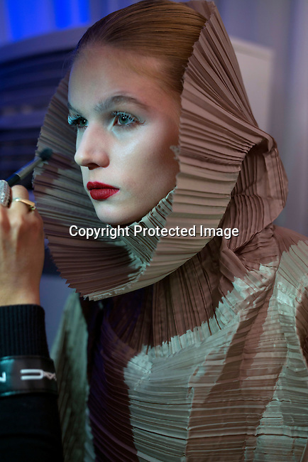 CAPE TOWN, SOUTH AFRICA JULY 30: A model walking for the designer Habits gets touch up son her make-up backstage before a show on July 30 2015 at the V&A Watershed in Cape Town, South Africa. Habits is one of South Africa's most established designers and they showed at the yearly Mercedes Benz Cape Town Fashion Week, where some of South Africa's finest designers showed their Spring/Summer 2016 collections, during the 3-day event. (Photo by Per-Anders Pettersson)