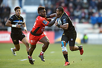 Aled Brew of Bath Rugby fends Josua Tuisova of Toulon. European Rugby Champions Cup match, between RC Toulon and Bath Rugby on December 9, 2017 at the Stade Mayol in Toulon, France. Photo by: Patrick Khachfe / Onside Images