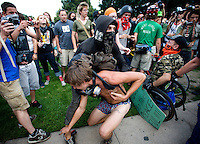 Police clash with protesters during a spontaneous march during the 2008 Democratic National Convention in Denver, Colorado, USA, Monday, August 26, 2008. About 50 people were arrested during the protest...PHOTOS/  MATT NAGER