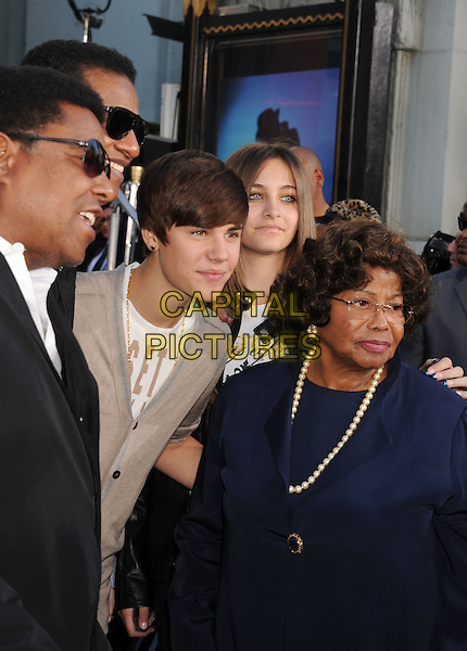 Jackie Jackson, Justin Bieber, Paris Jackson, Katherine Jackson.Grauman's Chinese hand and foot print ceremony for the late Michael Jackson, celebrating the Los Angeles debut of Michael Jackson THE IMMORTAL World Tour by Cirque du Soleil held at Grauman's Chinese Theatre, Hollywood, California, USA..January 26th, 2012.half length black blue top pearl necklace beige cardigan .CAP/ROT/TM.©Tony Michaels/Roth Stock/Capital Pictures