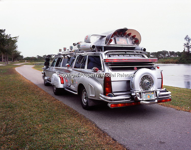 Two mercedes station wagons combined into one recreational vehicle.
