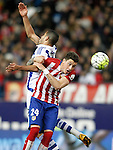 Atletico de Madrid's Jose Maria Gimenez (r) and Real Sociedad's Jonathas de Jesus during La Liga match. March 1,2016. (ALTERPHOTOS/Acero)