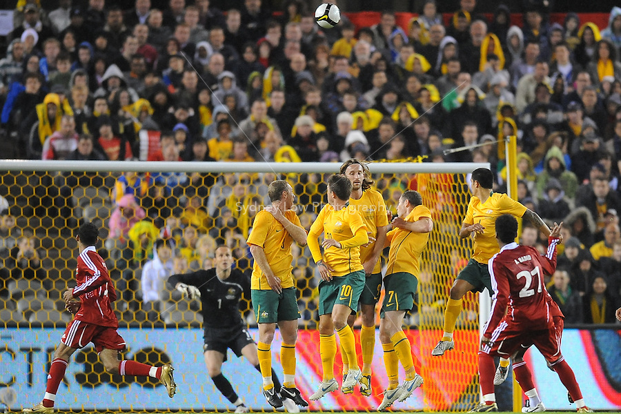 MELBOURNE, AUSTRALIA - OCTOBER 14: Players watch the ball from a free kick in a AFC Asian Cup 2011 match between Australia and Oman at Etihad Stadium on October 14, 2009 in Melbourne, Australia. Photo Sydney Low www.syd-low.com