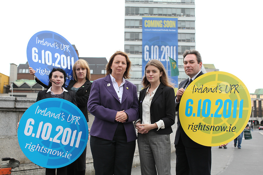 """NO REPRO FEE. 22/9/2011. Orla Tinsley Launches Rights Campaign's Big Banner on Dublin's Liberty Hall. L-R Helena Clarke, Integration centre, Anthea McTeirnan IFPA chair and Irish Times, Senator Jillian Van Turnout, Childrens rights alliance, Author, journalist and health rights campaigner Orla Tinsley and Mark Kelly ICCL joins rights campaigners to launch the """"Your Rights Right Now"""" campaign's flagship 25 metre-high banner, which was unfurled on Dublin's Liberty Hall. The appearance of the banner, which will dominate the Liffey skyline for the next fortnight, marks the final countdown to Ireland's first ever full hearing on its human rights record under the United Nations 'Universal Periodic Review' (UPR) in Geneva on 6th October 2011. For further information, see the note below, and/or contact: Walter Jayawardene walter.jayawardene@iccl.ie. Tel. + 353 1 799 4503Mob: +353 87 9981574. Picture James Horan/Collins Photos"""