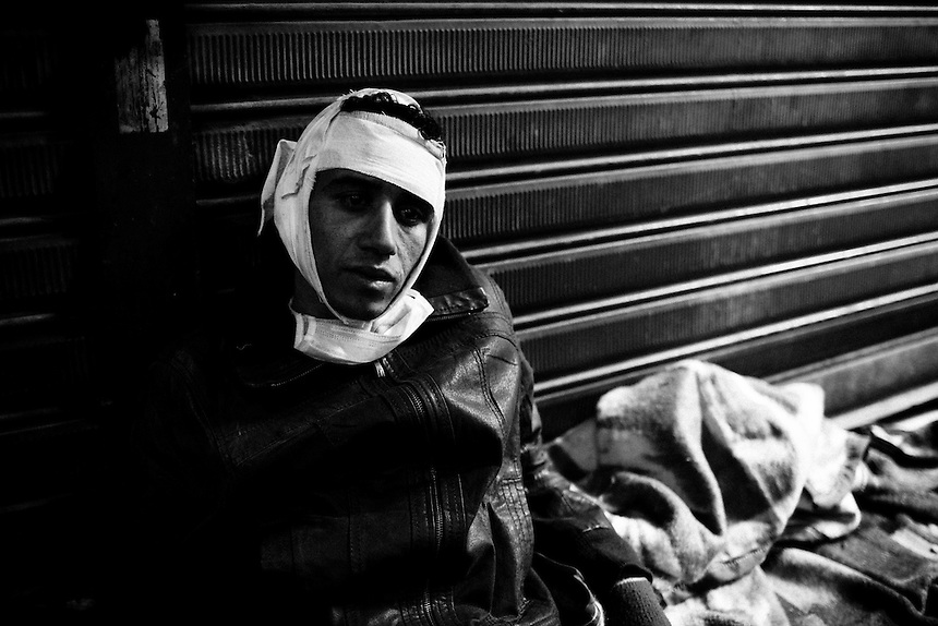An injured Egyptian protester recovers in a makeshift triage unit during clashes near Cairo's Tahrir Square, November 20, 2011. Photo: Ed Giles.