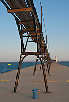 The Manistee Pierhead Light si shown with it's catwalk, a structure that was important for safety when lighthouses were manned and lightkeppers had to walk to the light in storms and dangerous conditions, manistee, Manistee County, Michigan