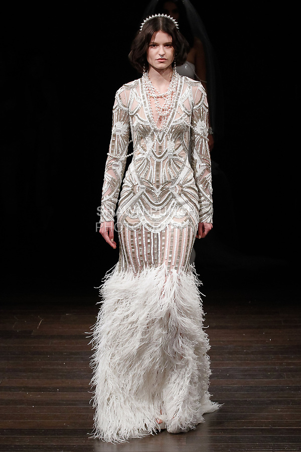 "Model walks runway in a ""Cuba"" bridal gown from the Naeem Khan Bridal Spring 2018 collection, on April 21, 2017; during New York Bridal Fashion Week."