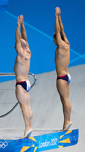 26 JUL 2012 - LONDON, GBR - Peter Waterfield (GBR) (left) and Tom Daley (GBR) (right) of Great Britain practice at the Aquatics Centre in the Olympic Park, Stratford, London, Great Britain ahead of the London 2012 Olympic Games 10m Synchronised Diving .(PHOTO (C) 2012 NIGEL FARROW)