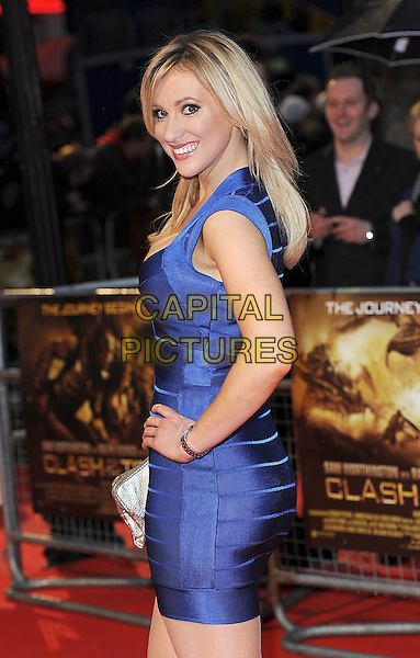 "REBECCA WALSH.The World Premiere of ""Clash Of The Titans"", Empire Leicester Square, London, England..29th March 2010.half length blue purple bandage body con smiling side hand on hip.CAP/BEL.©Tom Belcher/Capital Pictures."