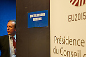 """A """"off the record"""" sign at the EU Council."""