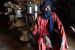 BURKINA FASO Dori , malische Fluechtlinge, vorwiegend Tuaregs, im Fluechtlingslager Goudebo des UN Hilfswerks UNHCR, sie sind vor dem Krieg und islamistischem Terror aus ihrer Heimat in Nordmali geflohen, Tuareg ATTIANE AG BADI aus Gao, OCADES (Caritas Niger) verteilt Kocher an Fluechtlinge /<br /> BURKINA FASO Dori, malian refugees, mostly Touaregs, in refugee camp Goudebo of UNHCR, they fled due to war and islamist terror in Northern Mali