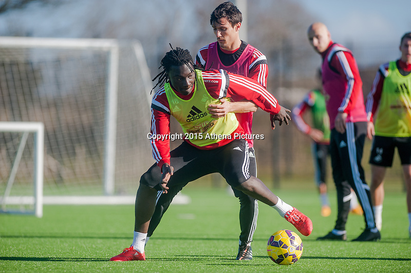 SWANSEA, WALES - FEBRUARY 17: Bafetibis Gomis of Swansea City  in action during a training session at the Fairwood training ground on February 17, 2015 in Swansea, Wales.  (Photo by Athena Pictures )