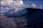 Teahupoo, Tahiti. May 2000. A boogie boarder  gets tubed at Teahupoo.